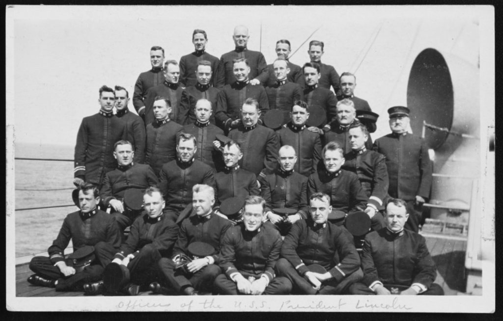 Ship's Junior Officers posed on board the USS President Lincoln, in early May 1918. The Lieutenant at the left end of the middle row is Edouard V.M. Izac, who was made a prisoner of war when President Lincoln was sunk on 31 May 1918. Courtesy of the Naval Historical Foundation, Washington, D.C. - USS President Lincoln Collection. U.S. Naval History and Heritage Command Photograph.